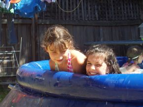 Girls_playing_in_a_small_pool
